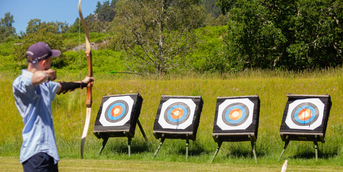 boy archer and targets