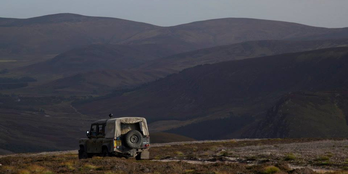 gamekeepers soft top land rover on hill track on Scottish grouse moor