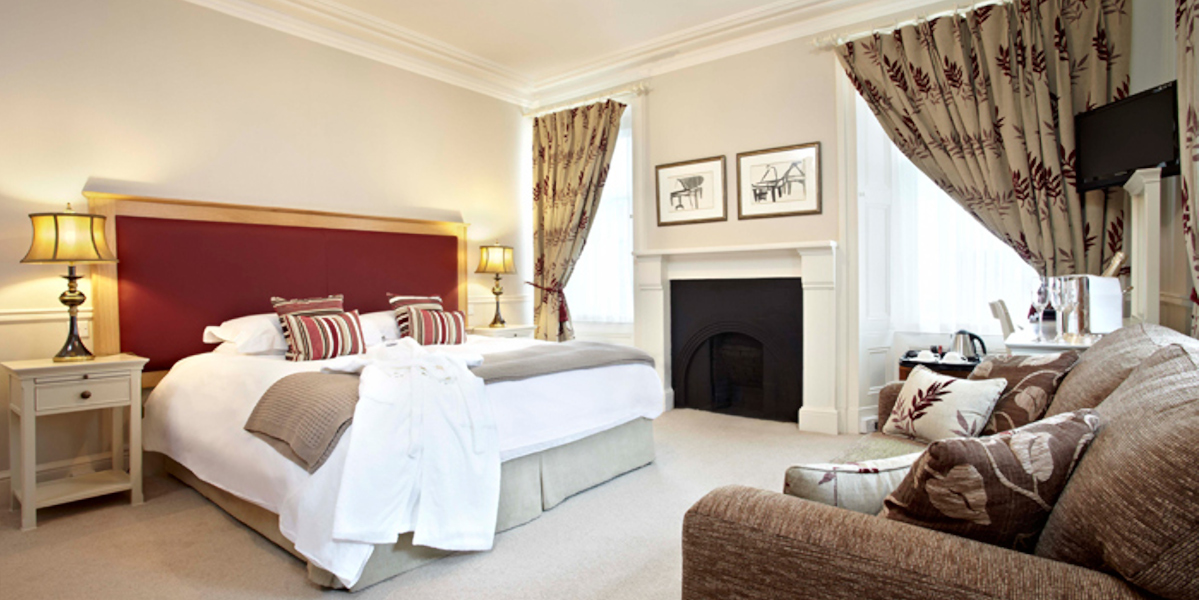 spacious hotel room with double bed