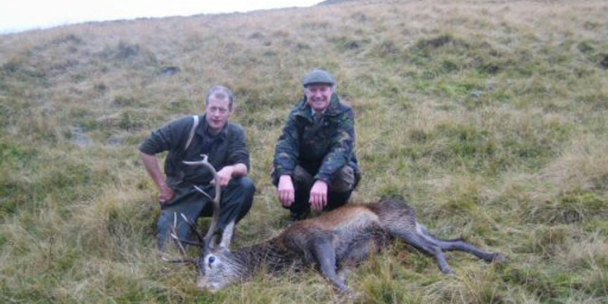 Invercauld_estate_2_stalkers_with_red_deer_stag_Scottish_Hill