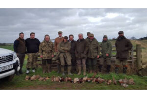 row of game shooters with shot birds