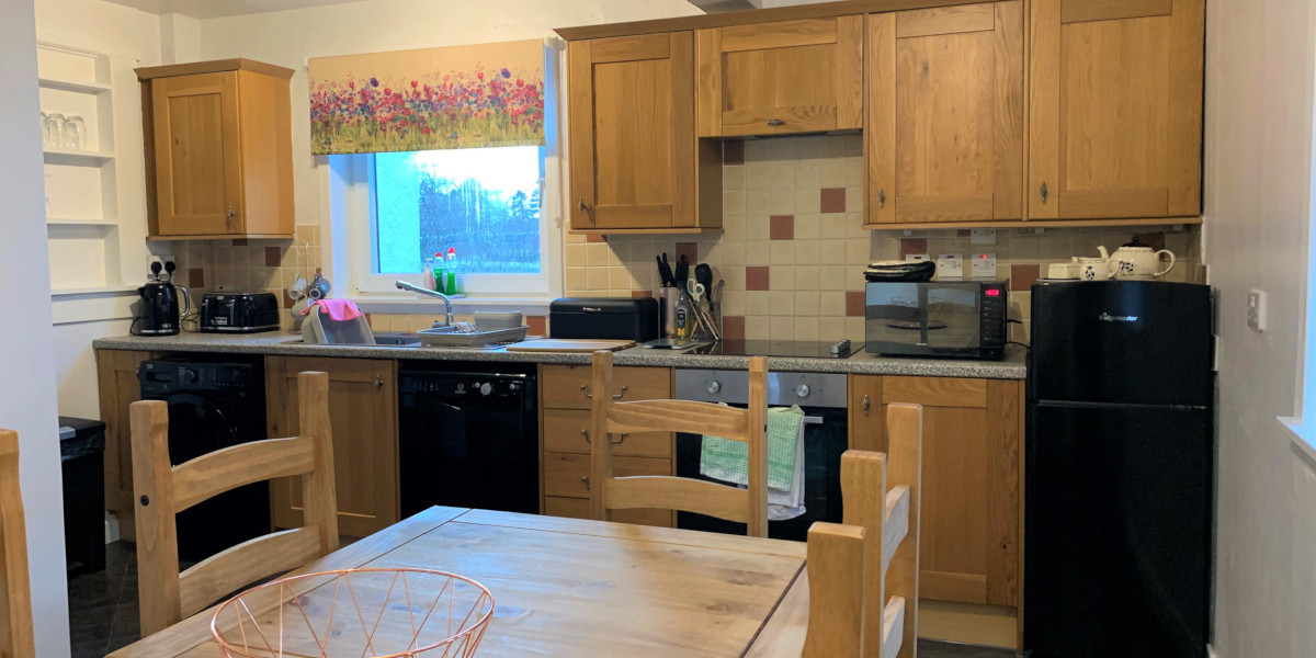 cottage kitchen diner with oak units, table and chairs