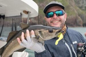 happy fisherman with sea fish