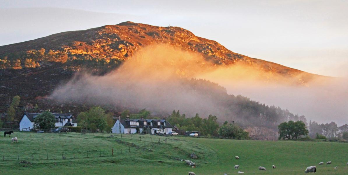 Scottish cottages set on sunlit hillside