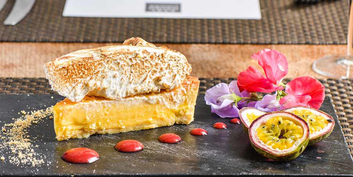 hotel plate of sweet food lemon meringue pie and passion fruit