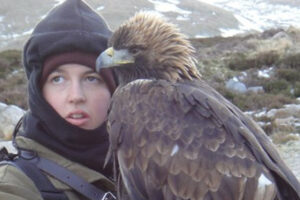 Falconer with eagle