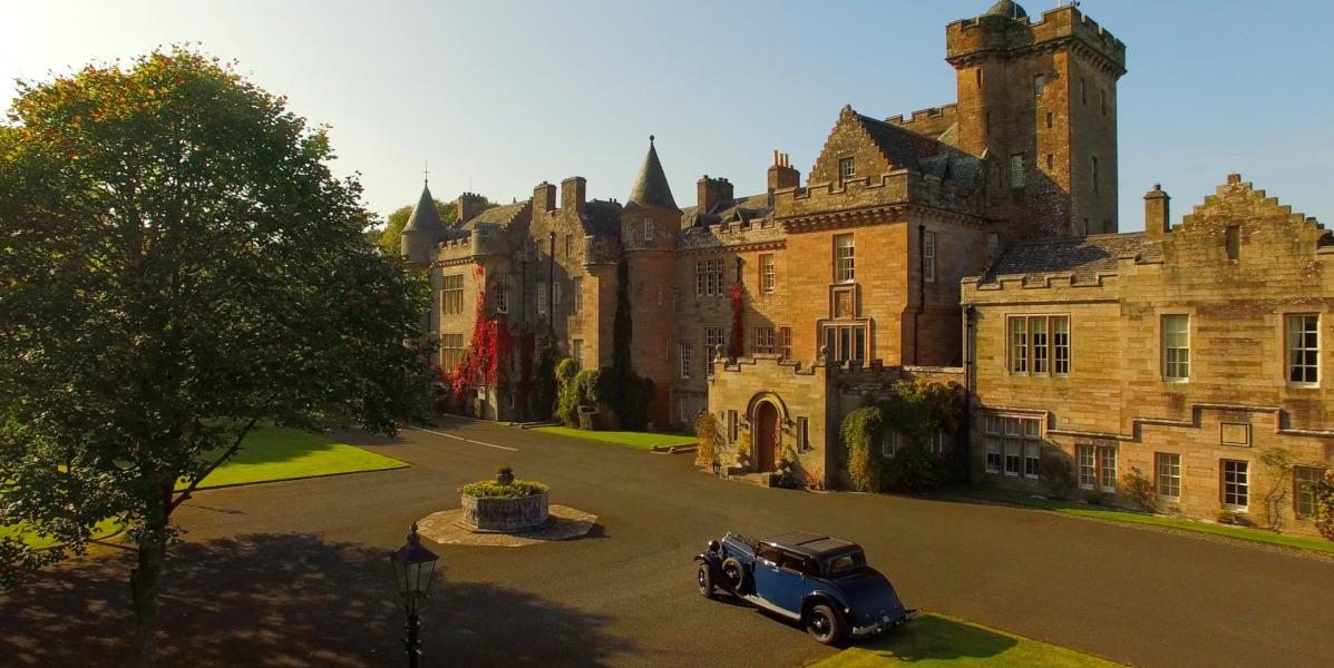 Glenapp Castle front elevation with blue vintage car