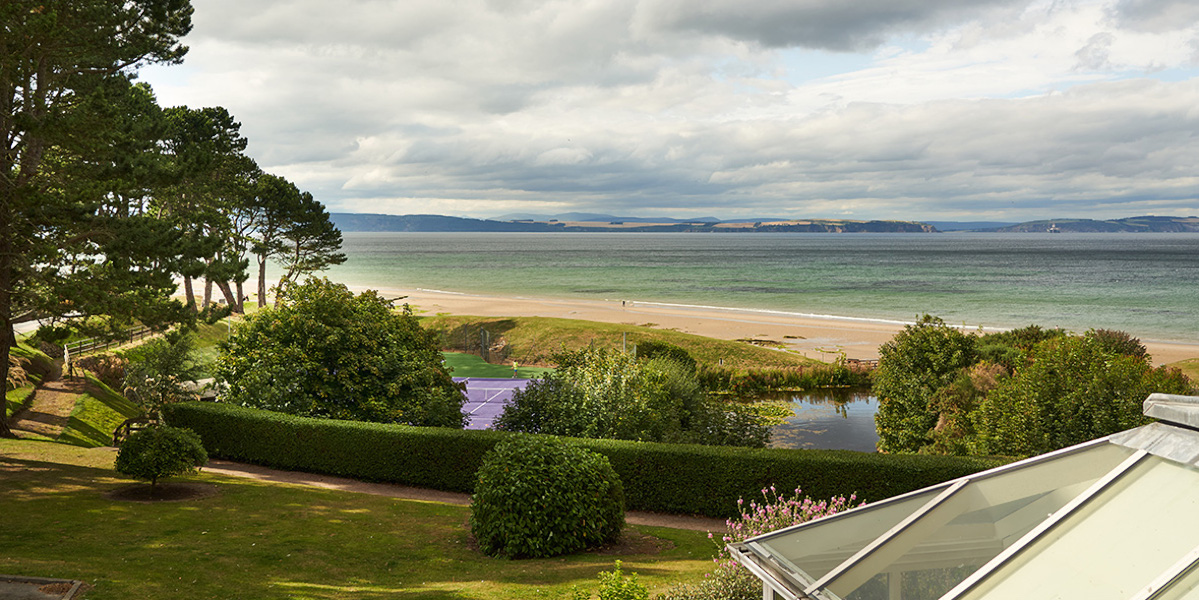 view of sandy beach with Scottish mountains in distance