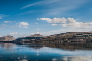 Scottish sea loch view with mountains and blue sky