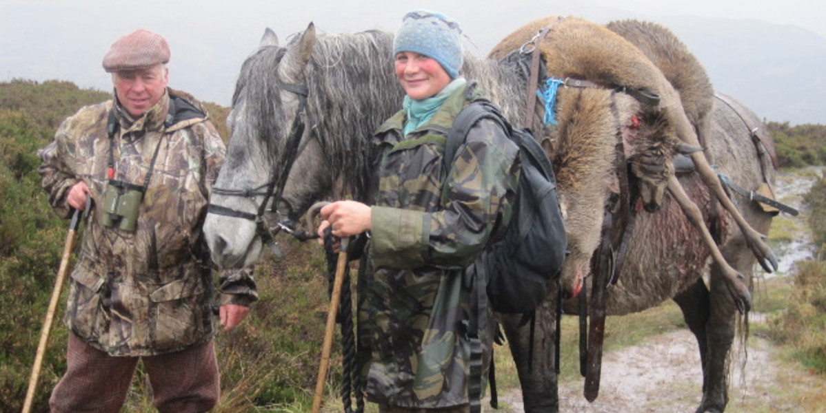 stalker, handler and hill pony with stag