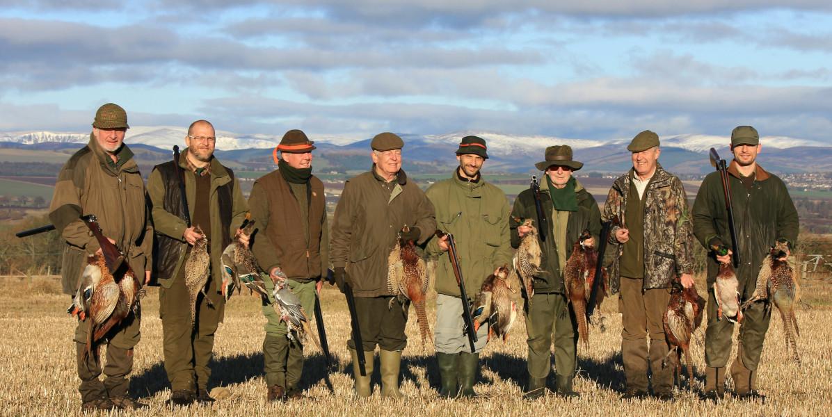 team of game bird guns with pheasants