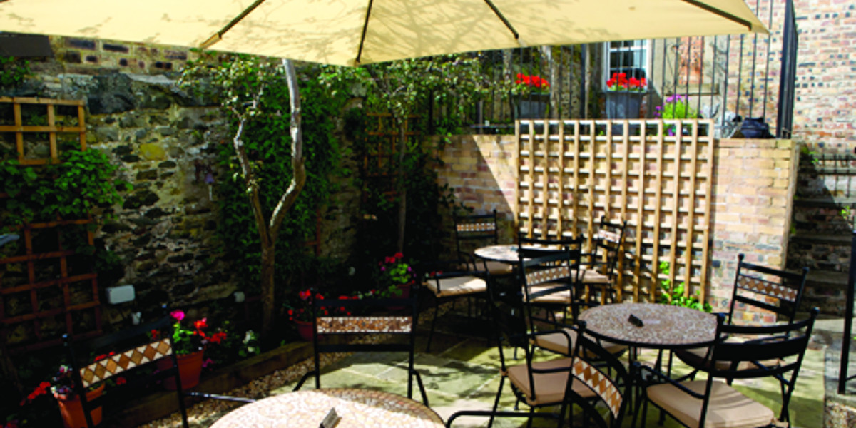 beer garden with parasol and 3 sets outdoor tables and chairs