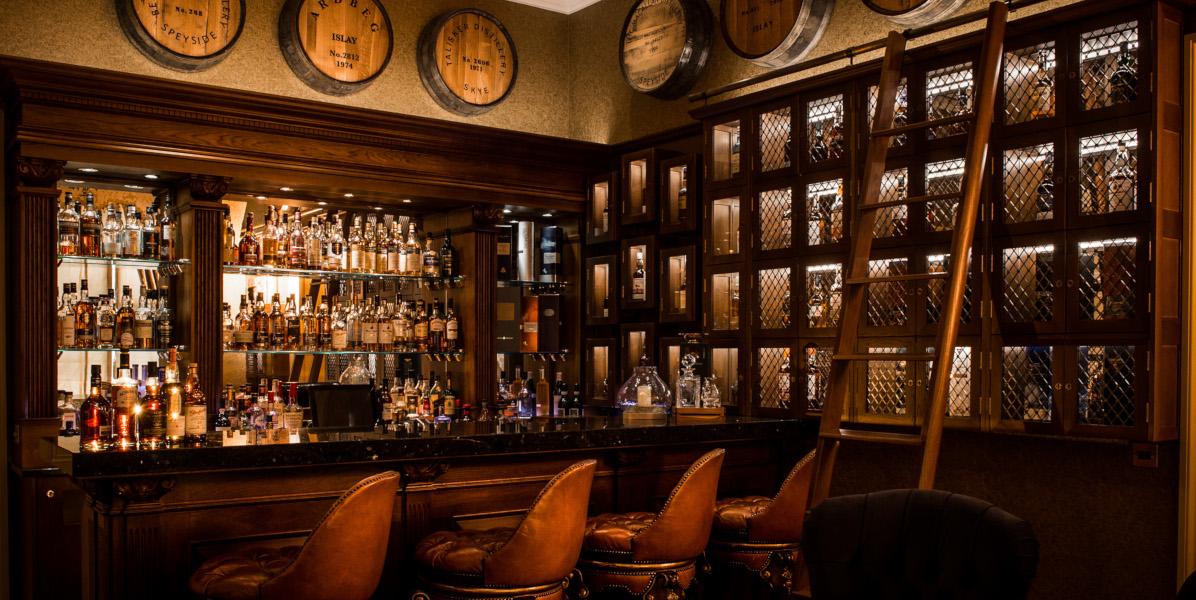 whiskey bar with bar stools