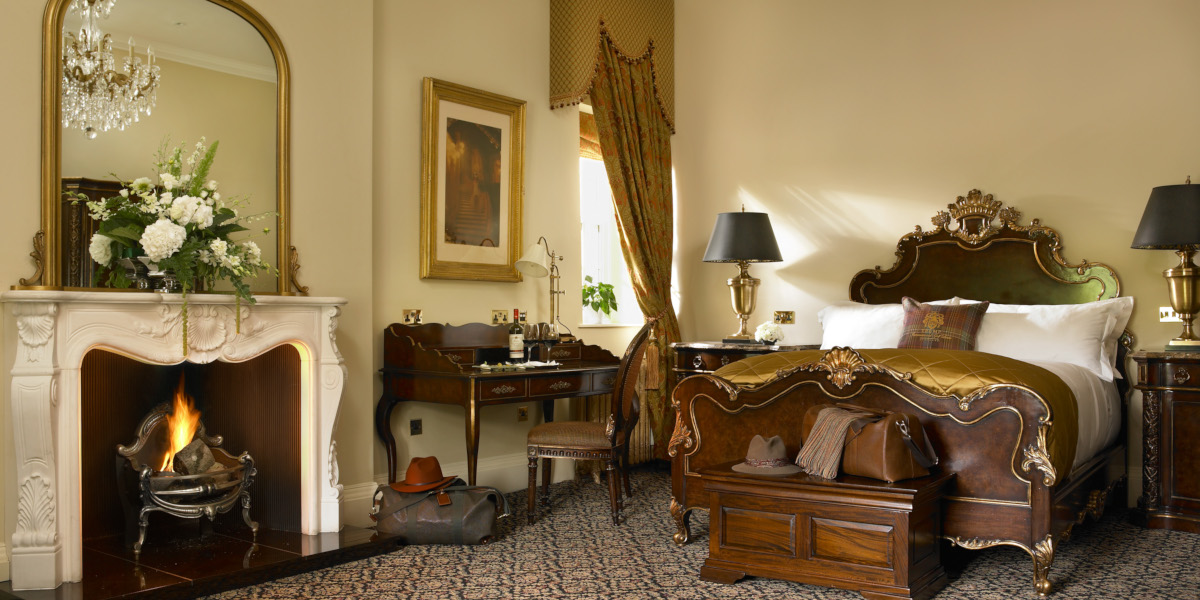 Luxury hotel room with open fire and writing desk