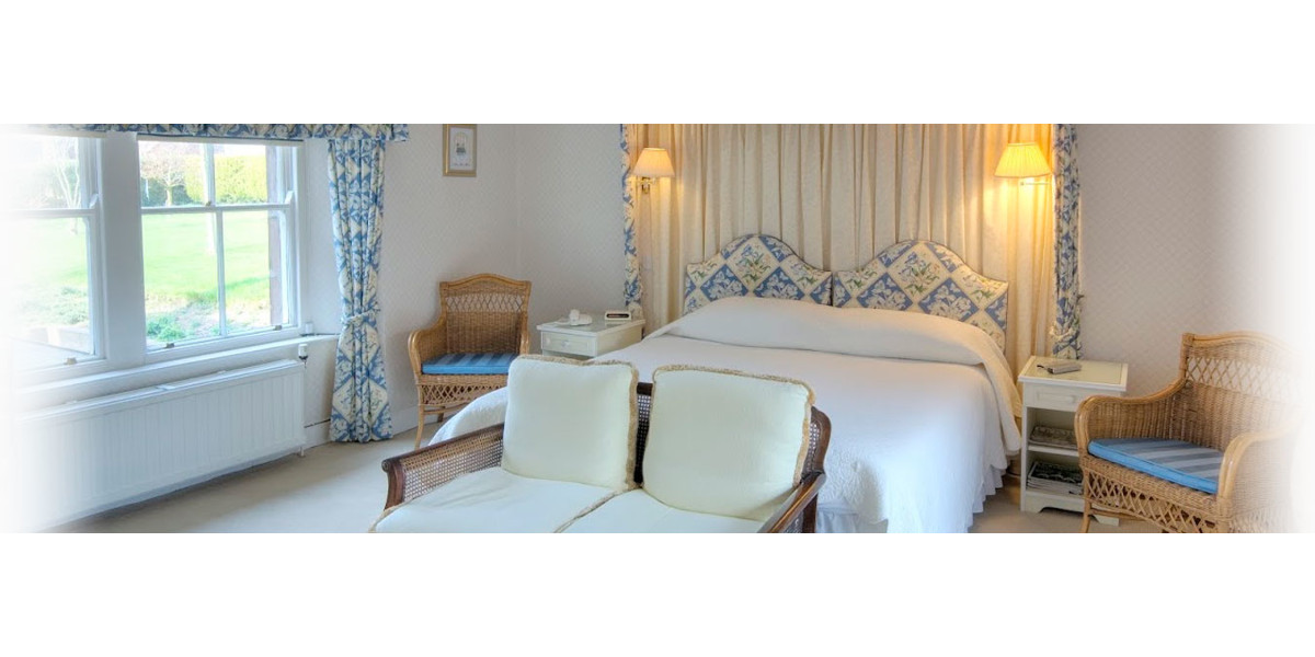 hotel double bedroom with yellow and blue decor accents