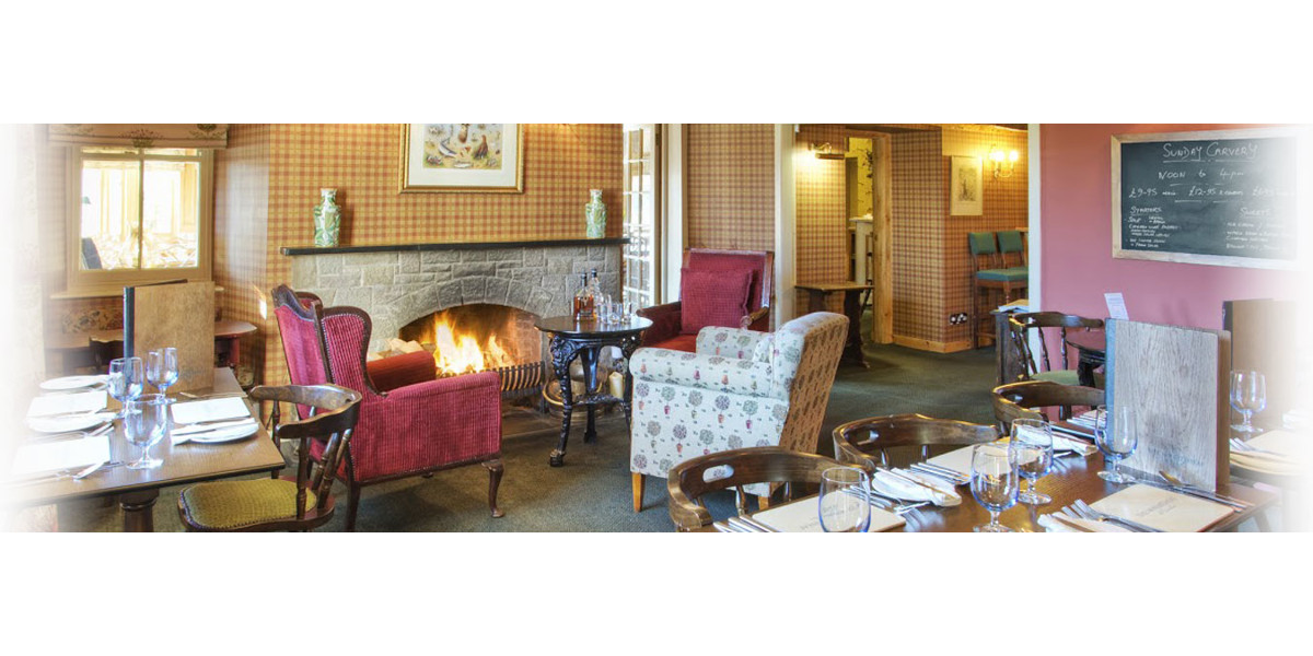 hotel dining room with lit open fire