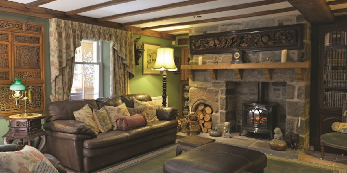 lounge with sofas and woodburner
