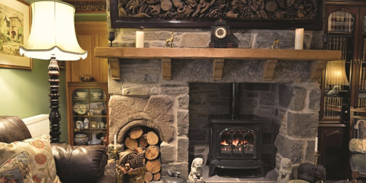 lounge with log store and wood burner