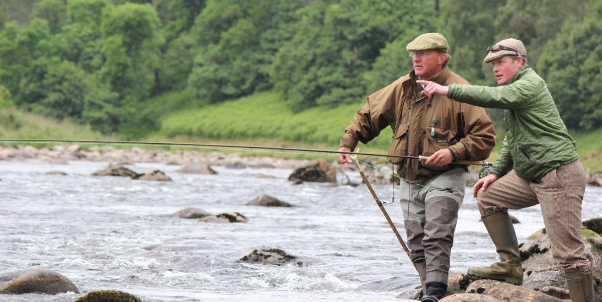salmon fly fisherman being guided