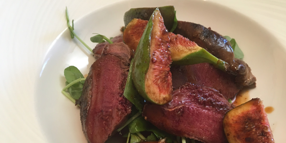 pigeon breasts on a plate with figs