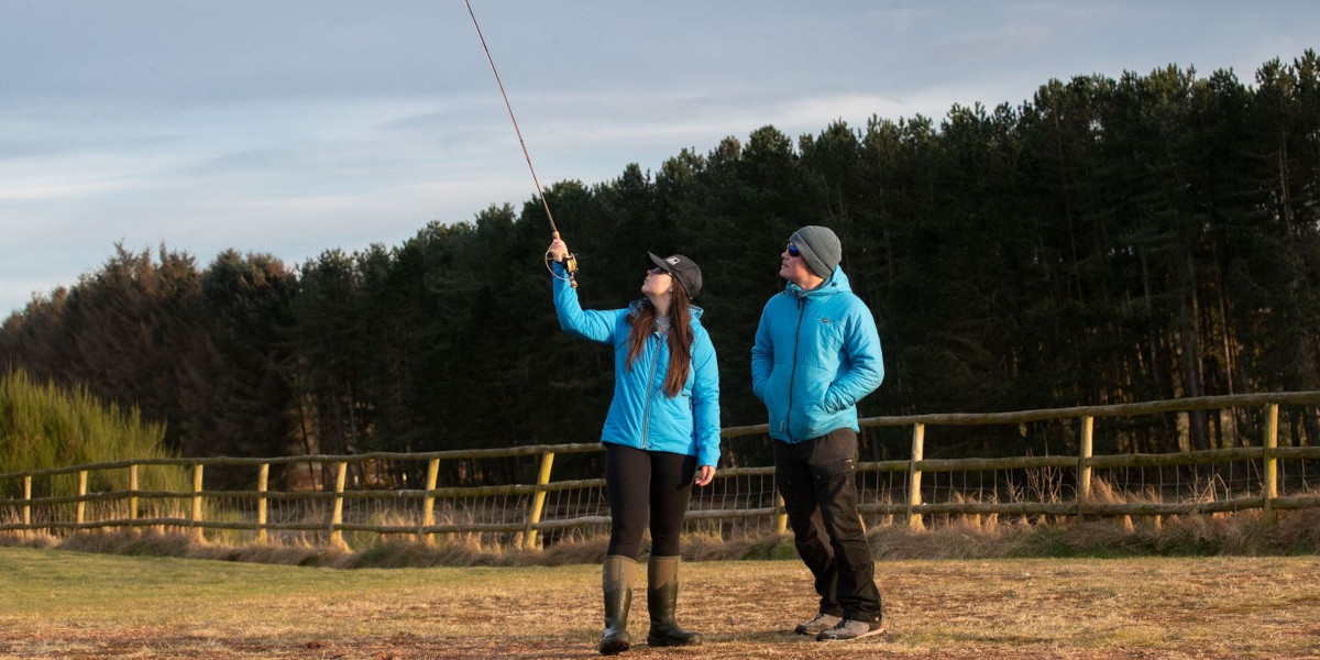 lady angler and guide with blue jackets learning fly fishing