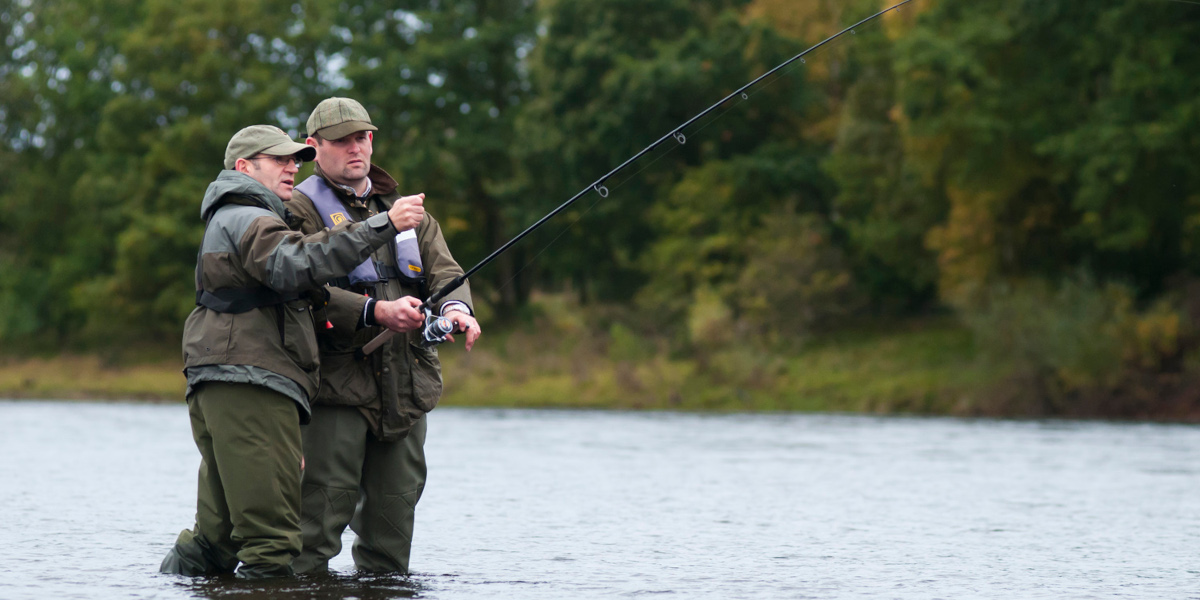 ghillie instructing angler on salmon river