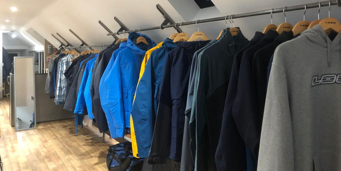 wet weather jackets on shop clothes rail