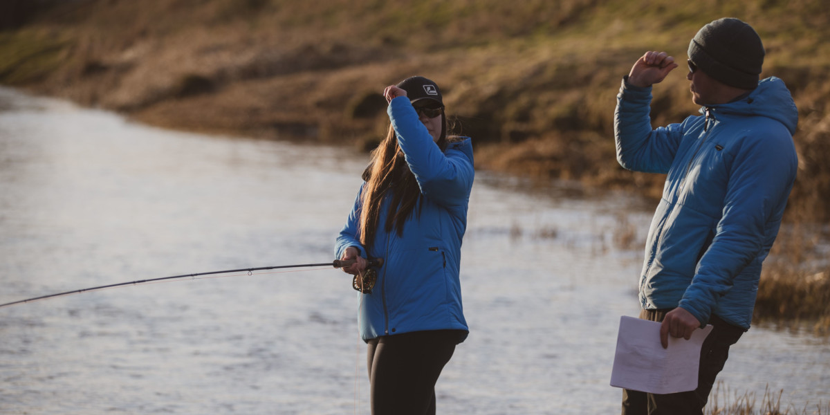 lady angler and guide with blue jackets fly fishing