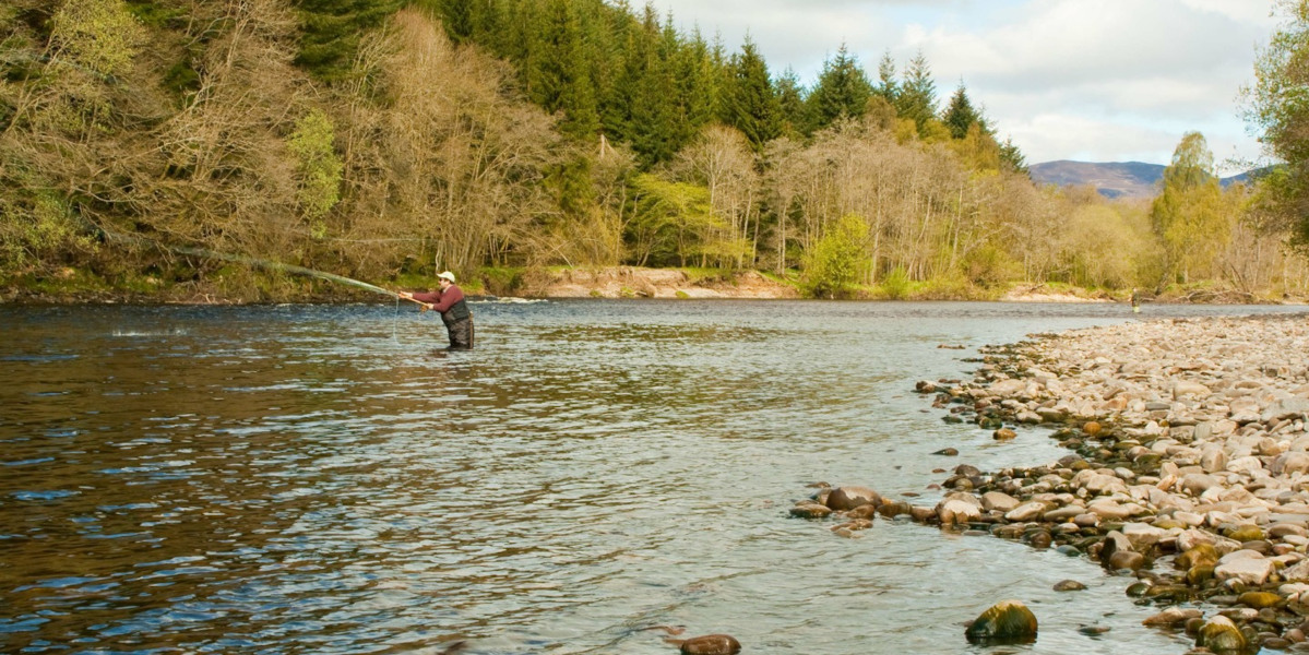 man fly fishing for salmon