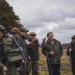 group of men with shotguns