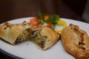 2 pheasant pasties on a plate