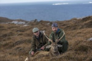 two hunters with stag