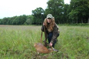 woman with deer carcass
