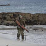 man on shoreline