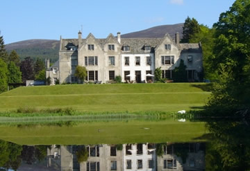Scottish country house overlooking large pond