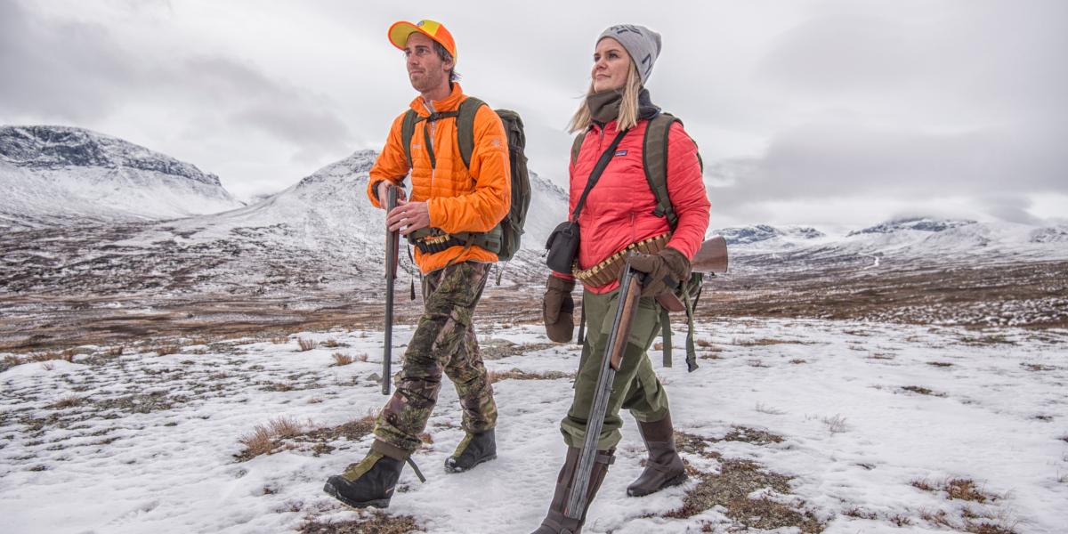 man and woman walking in snowy landscape