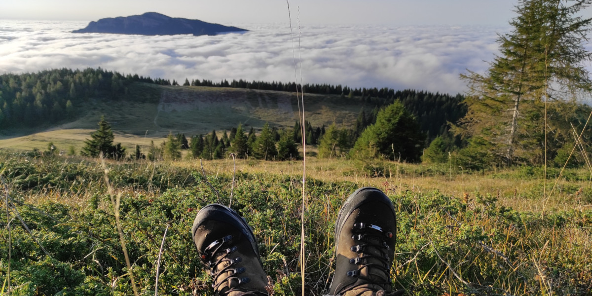 hilly landscape shot with pair of boots in foreground